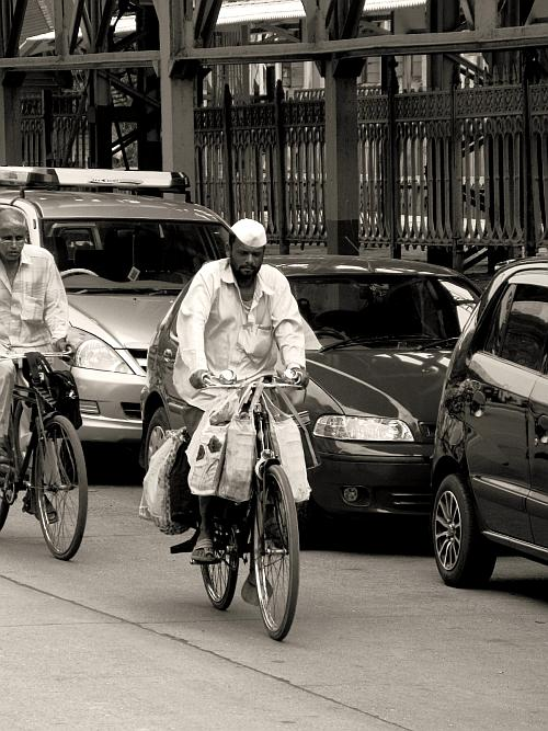 Dabba Walla on bicycle - Street Photos