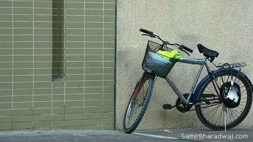 Delivery bicycle with neon jacket - Widescreen photo