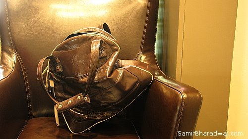 Leather handbag on a leather seat - Widescreen photo