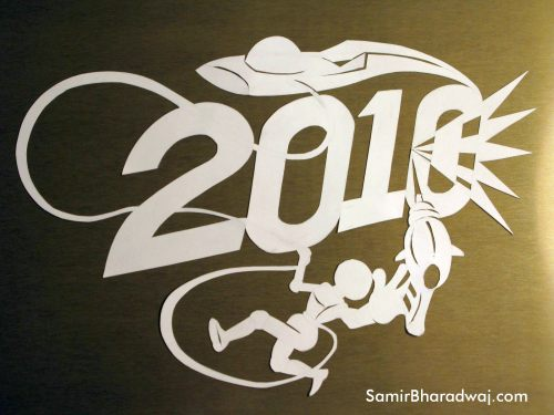 2010 paper cutting on a shiny board