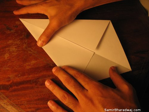 Creasing and folding an origami Diwali lamp - step 04