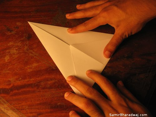 Creasing and folding an origami Diwali lamp - step 05