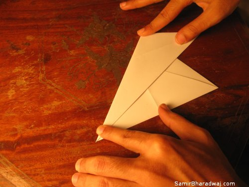 Creasing and folding an origami Diwali lamp - step 06