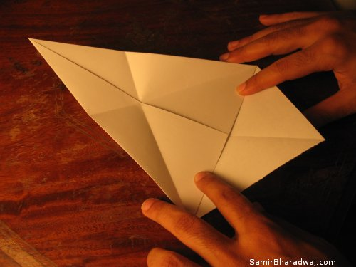Creasing and folding an origami Diwali lamp - step 07
