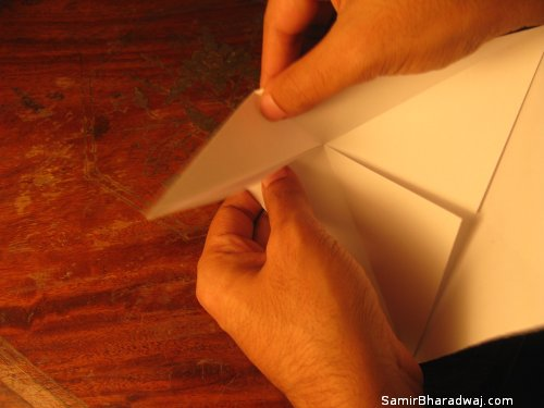 Creasing and folding an origami Diwali lamp - step 08