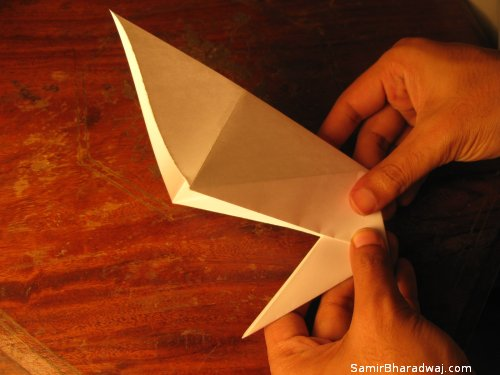 Creasing and folding an origami Diwali lamp - step 09