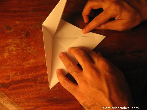 Creasing and folding an origami Diwali lamp - step 12