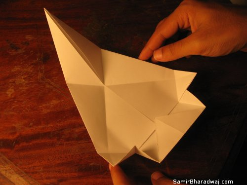 Creasing and folding an origami Diwali lamp - step 16