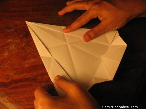 Creasing and folding an origami Diwali lamp - step 18