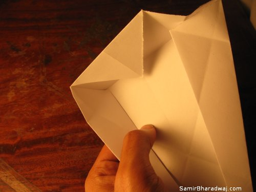 Creasing and folding an origami Diwali lamp - step 21