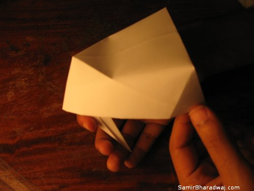 Creasing and folding an origami Diwali lamp - step 25