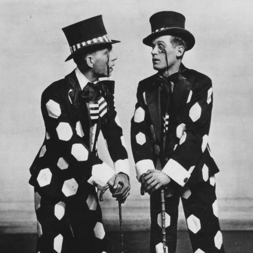 Comic pair in top hats and suits