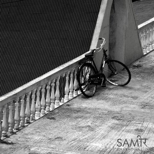 Bicycle leaning against a long decorative balustrade